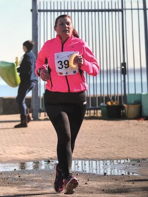 Sammantha running in charity run event